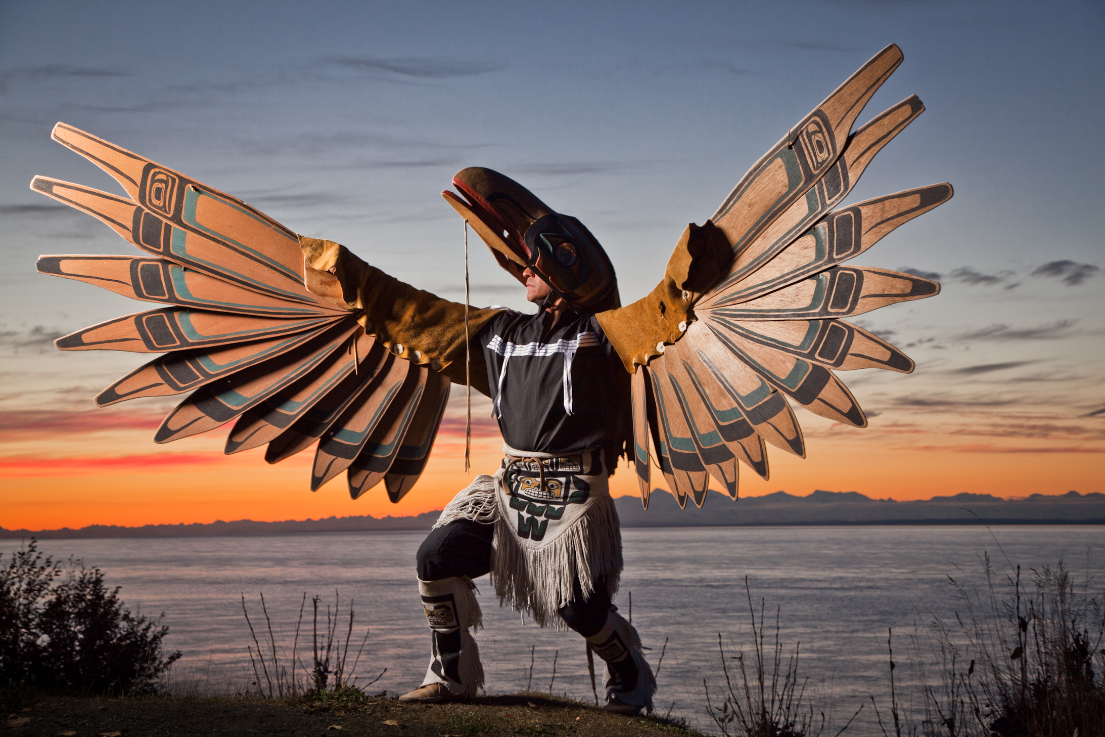 Inspirational performing artist and storyteller, Gene Tagaban, with his Raven Spirit costume, Anchorage, Alaska